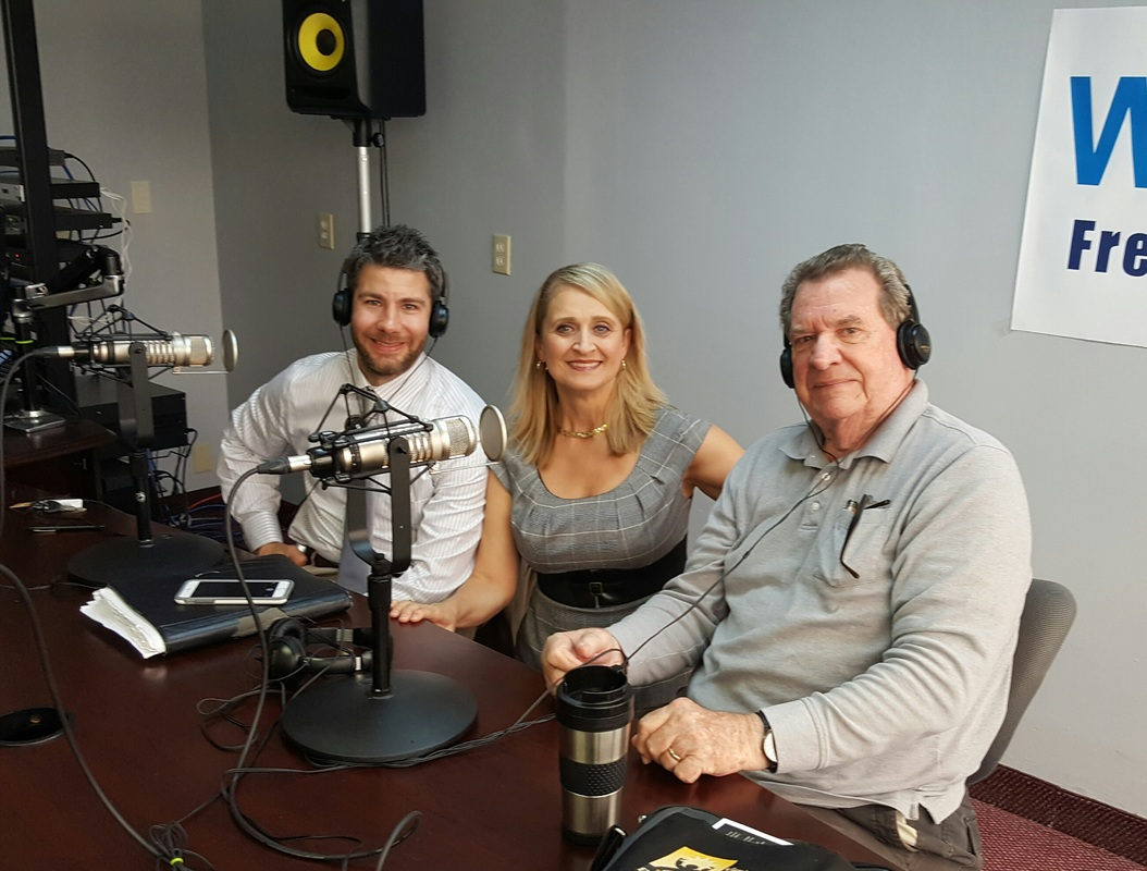 Dr. Christine Bacon, and guests Fred Watkins and Seth Doherty at the WKQA studio during a live show