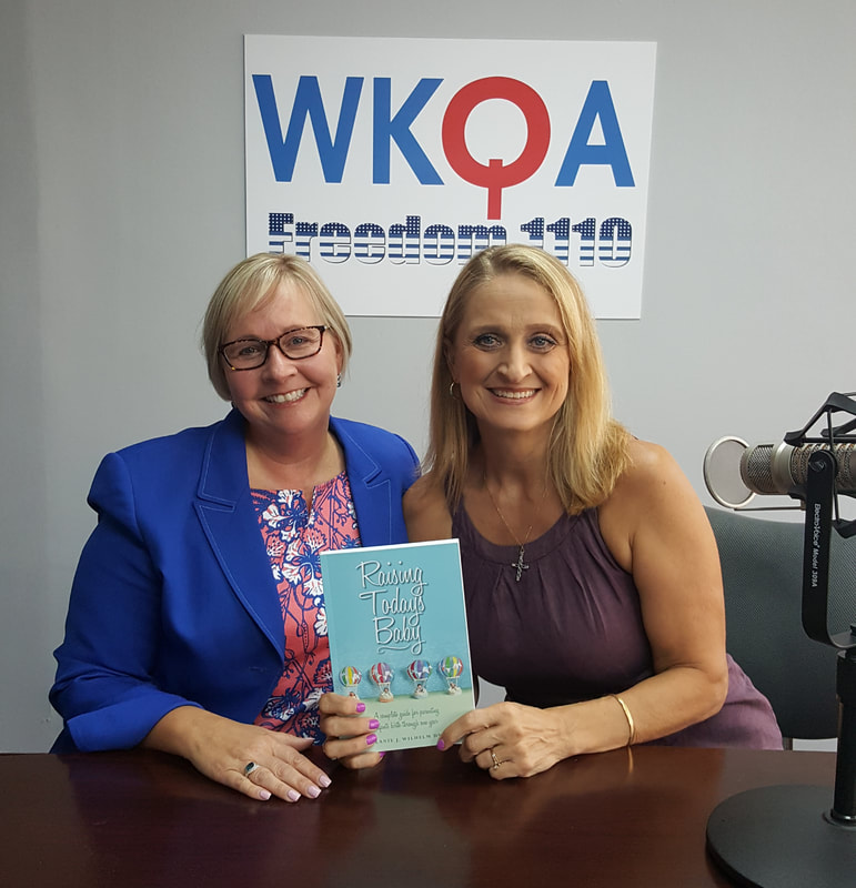 Dr. Melanie Wilhelm and Dr. Christine Bacon behind the microphone in the WKQA studios.