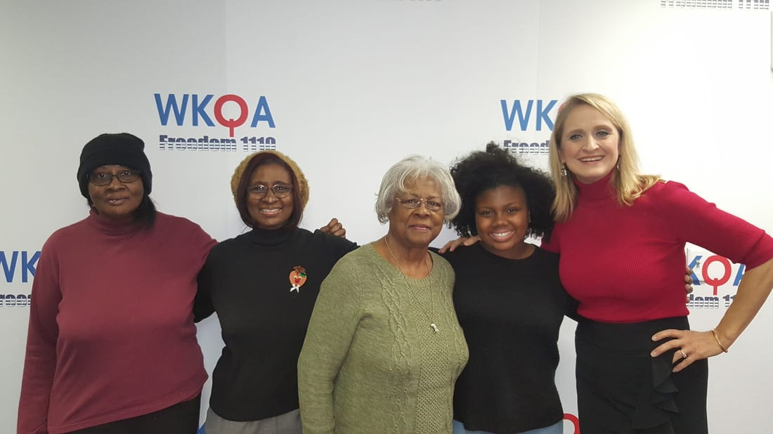 Three beautiful generations of Christian women snuggle with host Christine Bacon, Ph.D. at WKQA radio studio in Norfolk, Virginia.