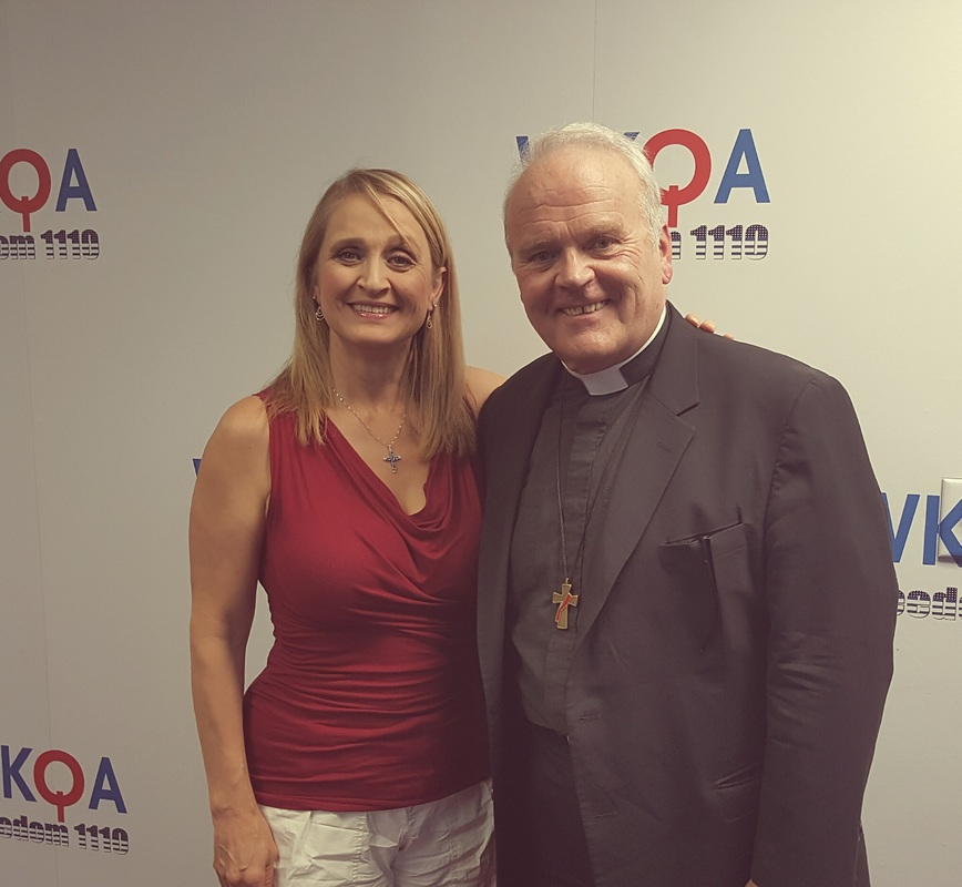 Dr. Christine M. Bacon and guest Rev. Mr. Keith Fournier at the WKQA studio.