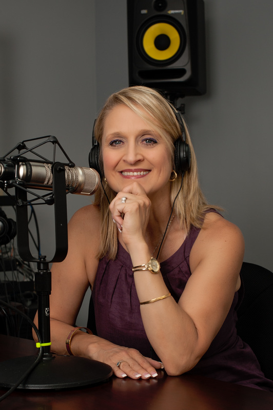 Dr. Christine M. Bacon in the WKQA studio