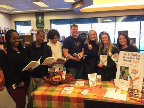 Dr. Christine Bacon at a recent book signing event flanked by some of her crazy students from Old Dominion University.