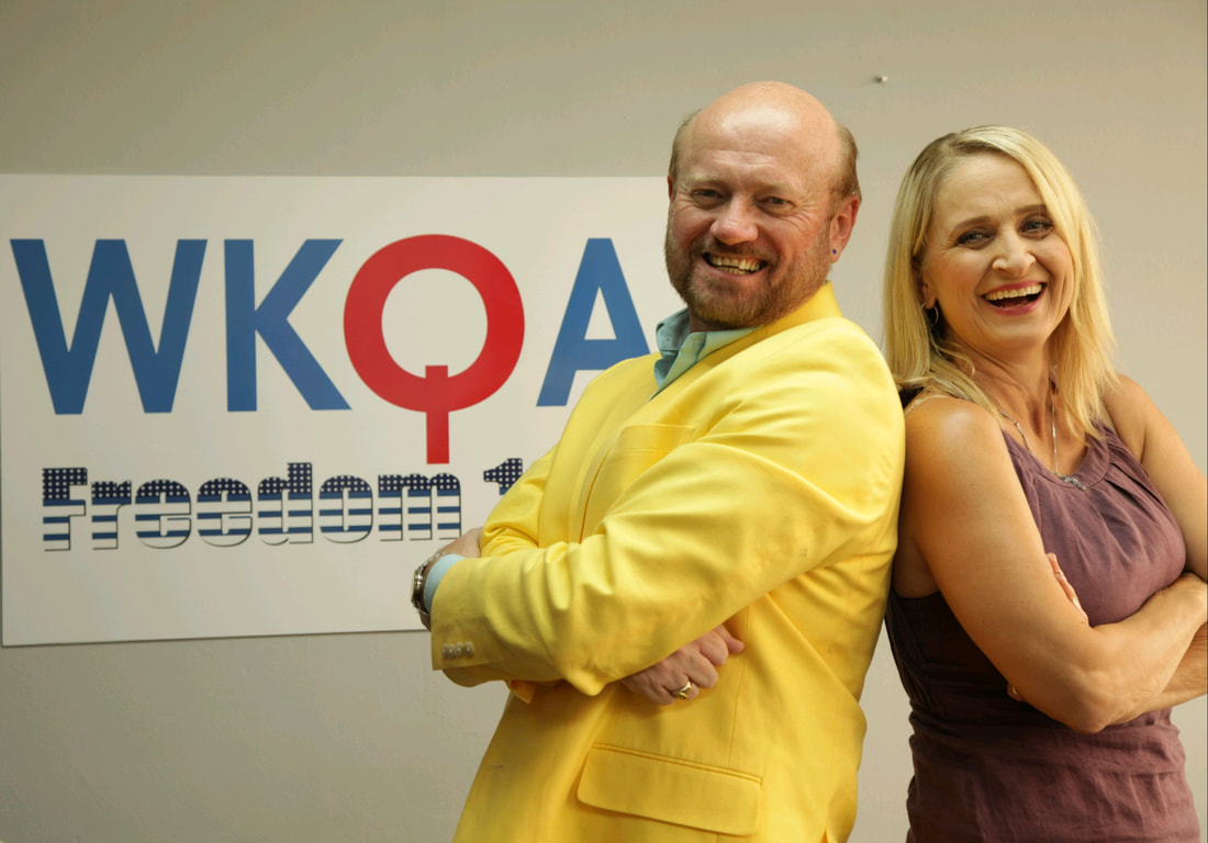 Dr. Campbell in his vibrant yellow suit coat to match his virant personality laughing with Christine Bacon after today's broadcast.