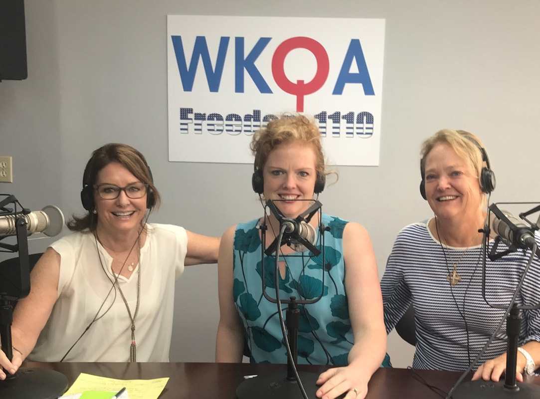 Anne-Ferrell, Lisa RObertson and her dughter Laura Robertson Kraus behind the microphones in the Breakfast with Bacon studio.