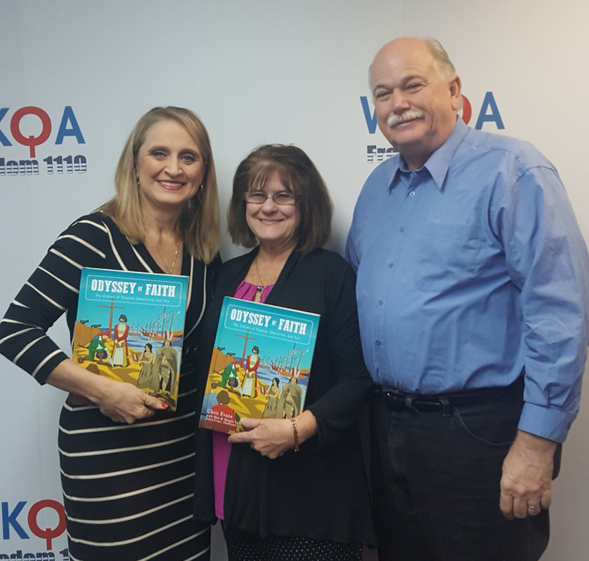 Guests Chris and Jim Evans at the WKQA studio all holding her new book.