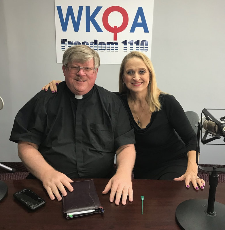Deacon Darrell Wentworth and Dr. Christine Bacon behind the radio desk at WKQA.