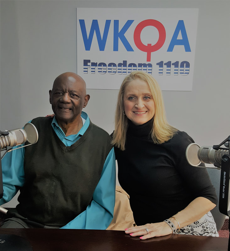 Drs. Jack Gaines and Christine Bacon behind the microphones at the WKQA radio desk.