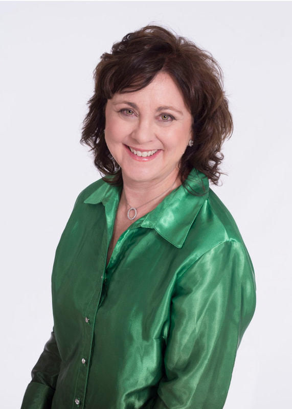 Dr. Morse in a smiling headshot of her in a green sating blouse.