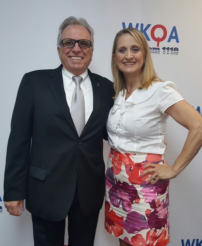 Host Christine Bacon posing at the WKQA studios in Norfolk, Virginia with recent guest Marty Angelo who is traveling the nation with his powerful story of conversion and redemption.