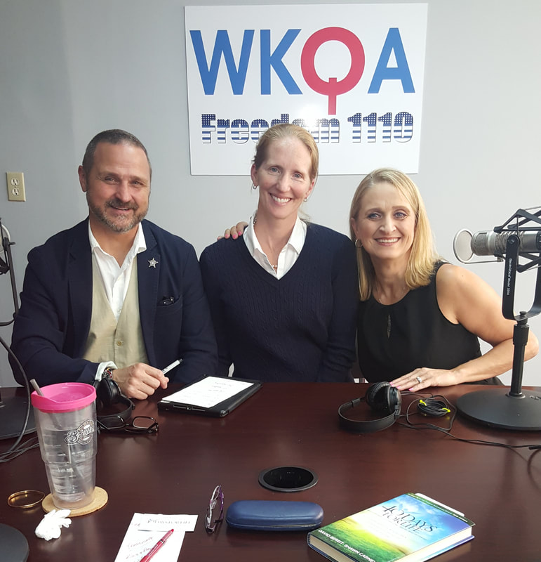 Matt and Libby Britton with Dr. Christine Bacon behind the microphones in the WKQA studios in Norfolk, Virginia.