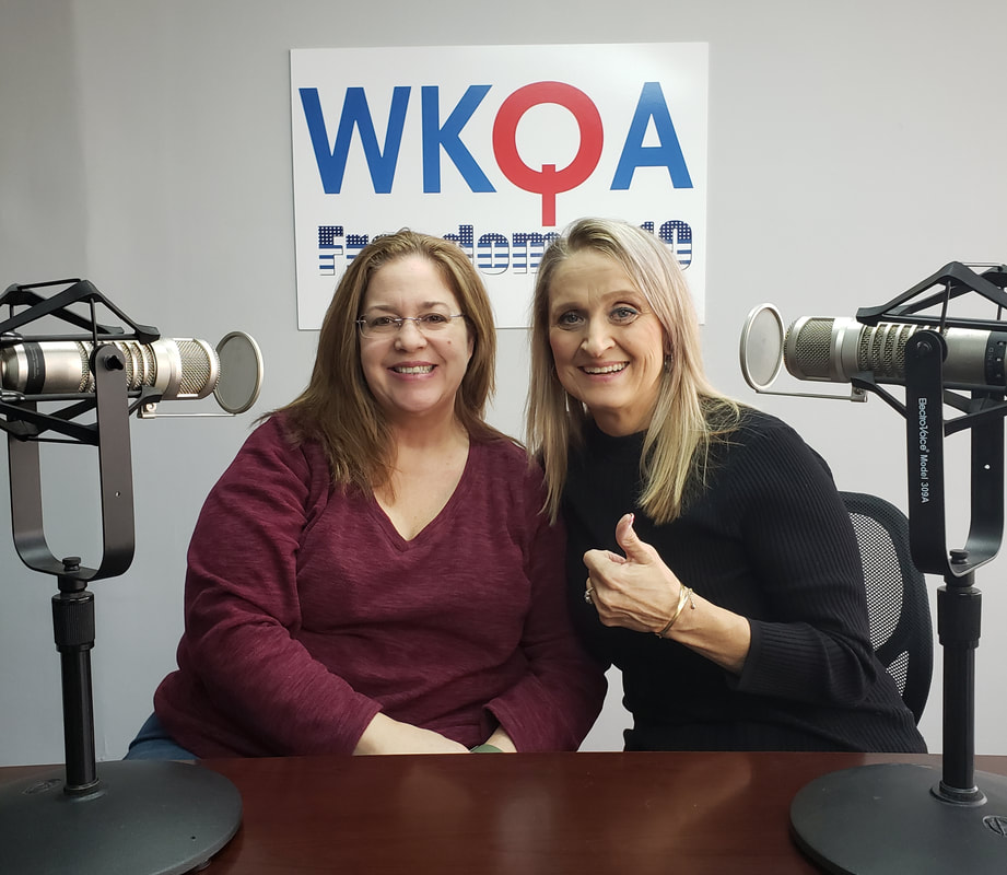 Drs. Sherry Wright and Christine Bacon sit behind the microphones in the WKQA studio.