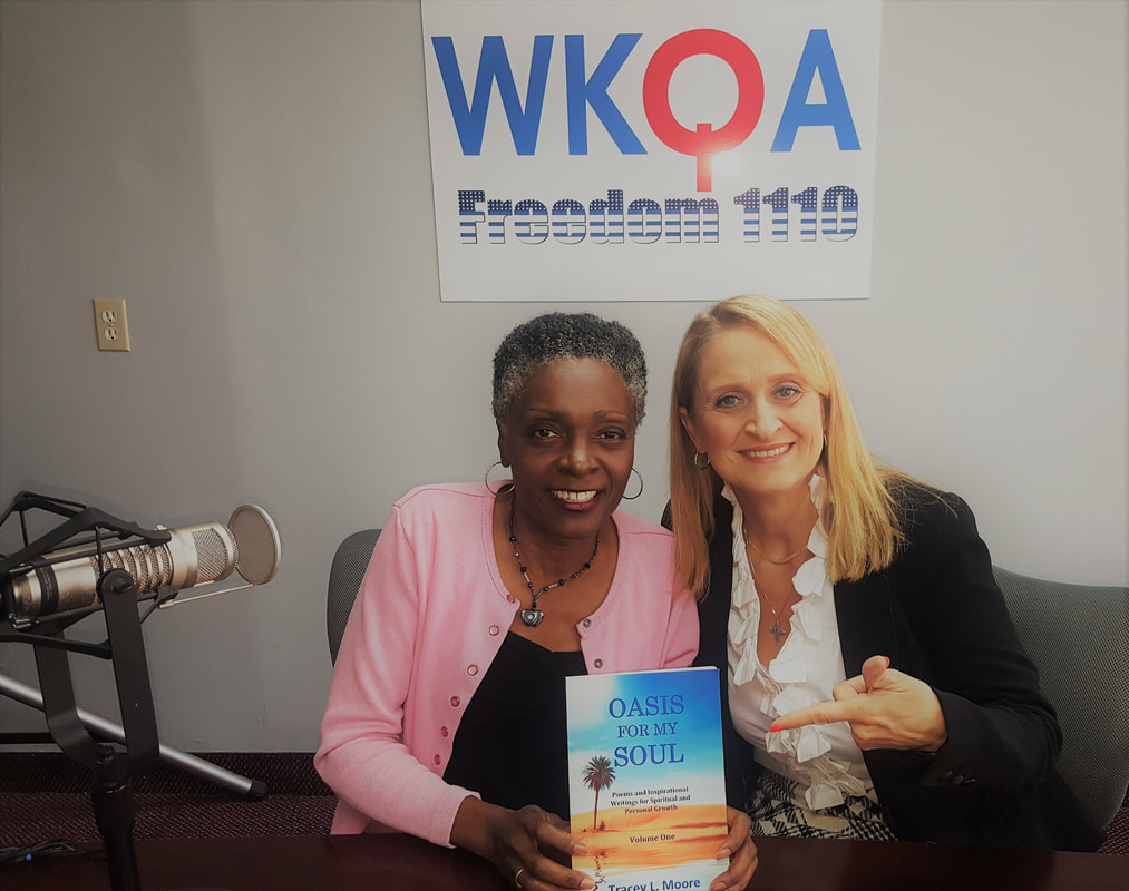 Tracey Moore and Christine Bacon sit together at the radio desk of WKQA after the broadcast.