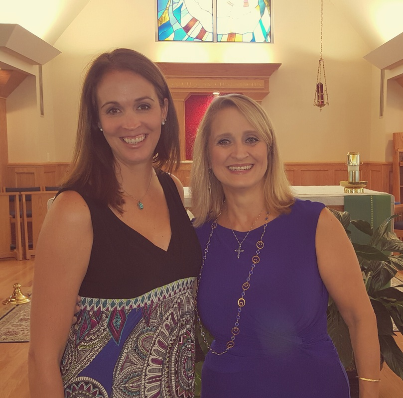 Guest Annelise Hartley, parish coordinator of Walking with Purpose Catholic women's bible study shares a hug with host Christine M. Bacon Ph.D. at their parish St. Stephen Martyr in Chesapeake, Virginia.