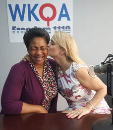 Dr. Bacon gives a great big kiss to her dear frind and radio show guest Deanna Stevens.